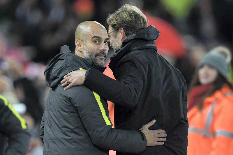 Liverpool's German manager Jurgen Klopp (R) greets Manchester City's Spanish manager Pep Guardiola ahead of the English Premier League football match between Liverpool and Manchester City at Anfield in Liverpool, north west England on December 31, 2016. (Photo by Paul ELLIS / AFP) / RESTRICTED TO EDITORIAL USE. No use with unauthorized audio, video, data, fixture lists, club/league logos or 'live' services. Online in-match use limited to 75 images, no video emulation. No use in betting, games or single club/league/player publications. /