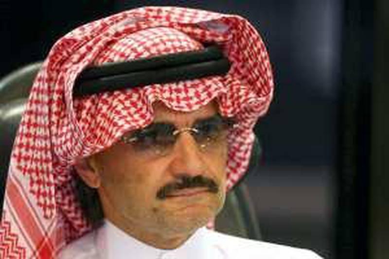 Saudi Prince Al-Waleed bin Talal attends a news conference in Riyadh August 30, 2009.   REUTERS/Fahad Shadeed    (SAUDI ARABIA POLITICS HEADSHOT ROYALS)