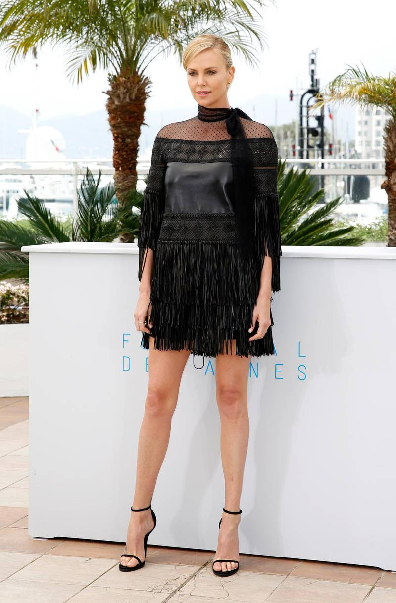 """CANNES, FRANCE - MAY 14:  Actress Charlize Theron attends a photocall for """"Mad Max: Fury Road"""" during the 68th annual Cannes Film Festival on May 14, 2015 in Cannes, France.  (Photo by Tristan Fewings/Getty Images)"""