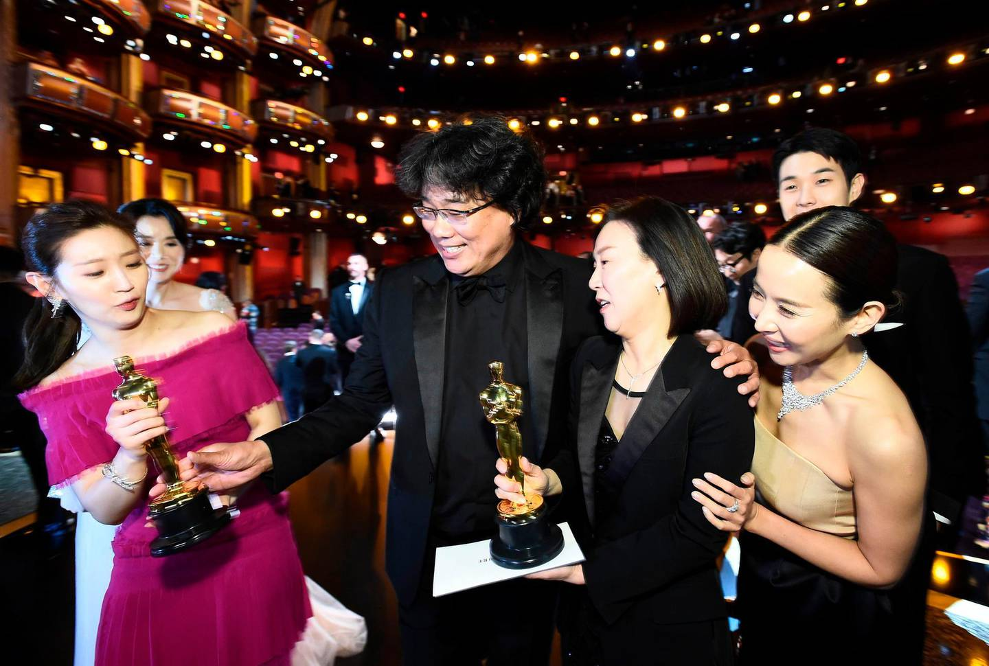 """TOPSHOT - In this handout photo provided by A.M.P.A.S. Best Picture Award winners for """"Parasite"""" pose onstage during the 92nd Annual Academy Awards at the Dolby Theatre on February 09, 2020 in Hollywood, California. RESTRICTED TO EDITORIAL USE - MANDATORY CREDIT """"AFP PHOTO / AMPAS/ Matt Petit"""" - NO MARKETING - NO ADVERTISING CAMPAIGNS - DISTRIBUTED AS A SERVICE TO CLIENTS  / AFP / AMPAS / AMPAS / Matt Petit / RESTRICTED TO EDITORIAL USE - MANDATORY CREDIT """"AFP PHOTO / AMPAS/ Matt Petit"""" - NO MARKETING - NO ADVERTISING CAMPAIGNS - DISTRIBUTED AS A SERVICE TO CLIENTS"""