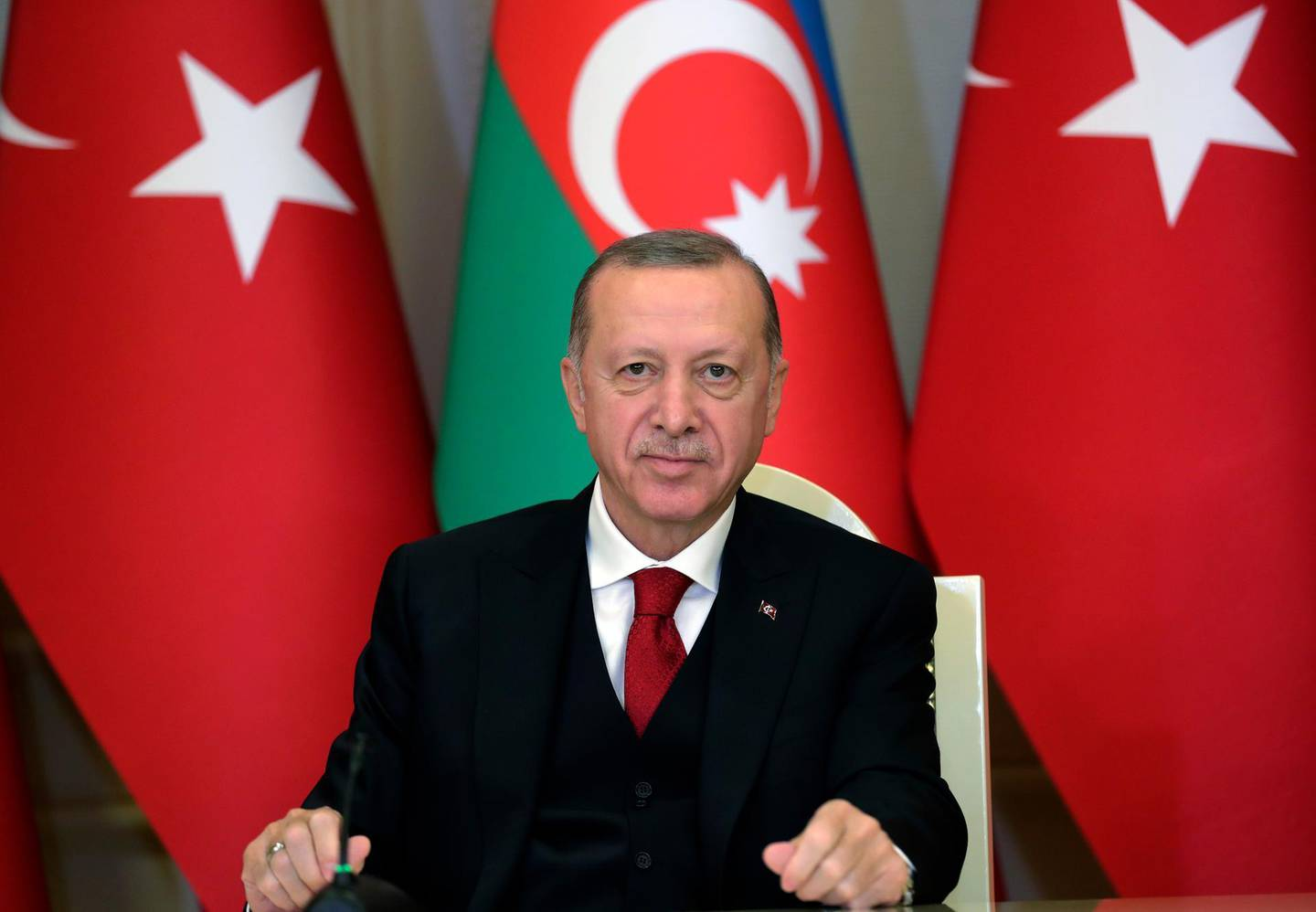 """Turkey's President Recep Tayyip Erdogan talks during a joint news conference with Azerbaijan's President Ilham Aliyev, in Baku, Azerbaijan, Thursday, Dec. 10, 2020. Following the approval of European leaders Friday Dec. 11, 2020 of expanding sanctions against Ankara, Turkey called on the European Union to act as an 'honest mediator' in its dispute with EU members Greece and Cyprus over the exploration of gas reserves in the Mediterranean. The leaders said early Friday that Turkey has """"engaged in unilateral actions and provocations and escalated its rhetoric against the EU.""""""""(Turkish Presidency via AP, Pool)"""