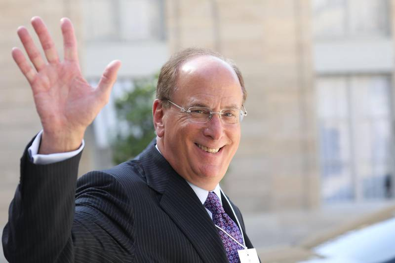 (FILES) In this file photo taken on July 10, 2019, Chairman and CEO of BlackRock, Larry Fink waves as he leaves a meeting about climate action investments at the Elysee Palace in Paris. BlackRock, sometimes called the most powerful company you have never heard of, has grown exponentially since its founding in 1988, especially since the 2008 financial crisis.  The company has been seen as a shadowy potential beneficiary of the French government's controversial pension system changes by critics of French President Emmanuel Macron. / AFP / Ludovic MARIN
