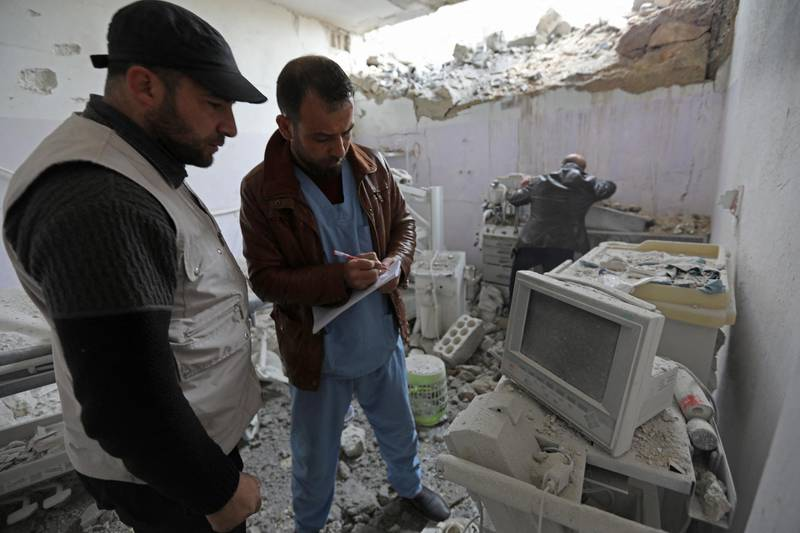 """Syrian medics check the damage at the """"Sham Surgical"""" hospital, one of several hospitals targeted by air strikes in Idlib province over the past few days, after it was hit in the middle of the night, in the northwestern town of Hass on February 15, 2018. (Photo by OMAR HAJ KADOUR / AFP)"""