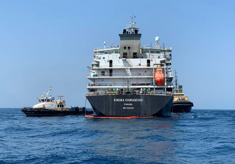 """TOPSHOT - A picture taken during a guided tour by the US Navy (NAVCENT) shows the Japanese oil tanker Kokuka Courageous off the port of the Gulf emirate of Fujairah on June 19, 2019. The Japanese tanker attacked in the Gulf of Oman last week was damaged by a limpet mine resembling Iranian mines, the US military in the Middle East said today. Commander Sean Kido of the US Navy told reporters that the US military has recovered biometric information of the assailants on the Japanese ship including """"hand and finger prints."""" Two oil tankers were damaged in twin attacks close to the Iranian coast on June 13, just outside the strategic Strait of Hormuz.  / AFP / Mumen KHATIB"""