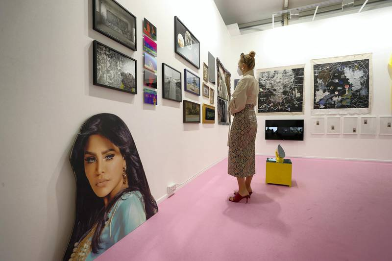 Dubai, United Arab Emirates - Reporter: Alexandra Chaves. Arts and Lifestyle. A visitor looks at the Athr Gallery booth. Art Dubai 2021 opens at the DIFC. Tuesday, March 30th, 2021. Dubai. Chris Whiteoak / The National