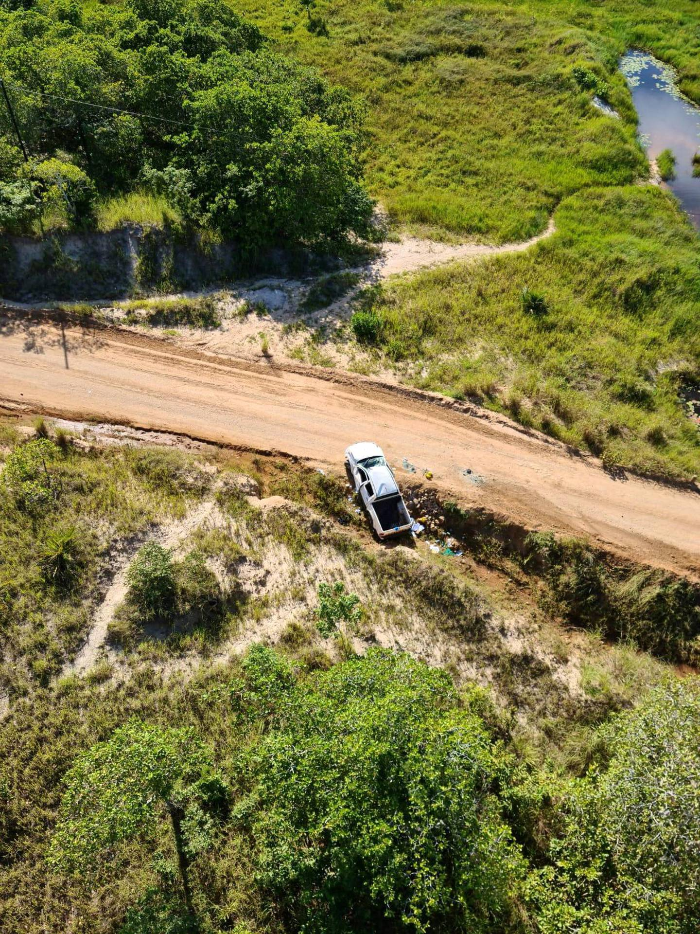 A car involved in an ambush on a convoy of vehicles carrying civilians who had been sheltering in a hotel in Palma, lies wrecked on the side of the road, in Mozambique, in this picture taken between March 24 and March 27, 2021 and obtained by Reuters on March 30, 2021. Dyck Advisory Group/Handout via REUTERS THIS IMAGE HAS BEEN SUPPLIED BY A THIRD PARTY. MANDATORY CREDIT.