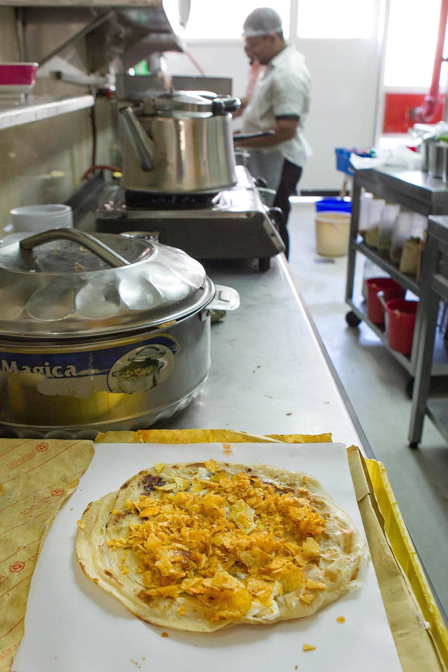 Abu Dhabi, United Arab Emirates. November 27, 2013///  Chips Oman sandwich at Baith Al Baraka (House of Blessings) cafeteria Bain Al Jessrain in Abu Dhabi, United Arab Emirates. Mona Al-Marzooqi/ The National   Reporter: Anna Zacharias Section: Weekend *** Local Caption ***  131127-MM-Chipsomansandwich-002.JPG