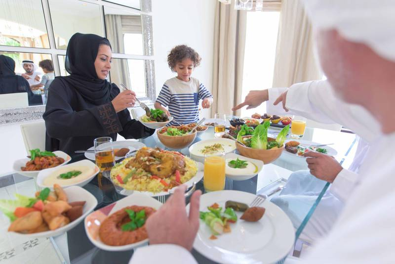 Family eating traditional arabic Mezze. Getty Images