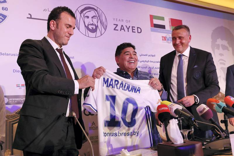 ABU DHABI , UNITED ARAB EMIRATES , MAY 22 – 2018 :- Left to Right - Dr Taj Eddine Seif , Partner  ,  Diego Maradona , Chairman of FC Dynamo Brest and Valdas Ivanauskas , Vice Chairman of FC Dynamo Brest presenting FC Dynamo Brest shirt during the press conference held at Emirates Palace hotel in Abu Dhabi.  ( Pawan Singh / The National )  For Sports. Story by John