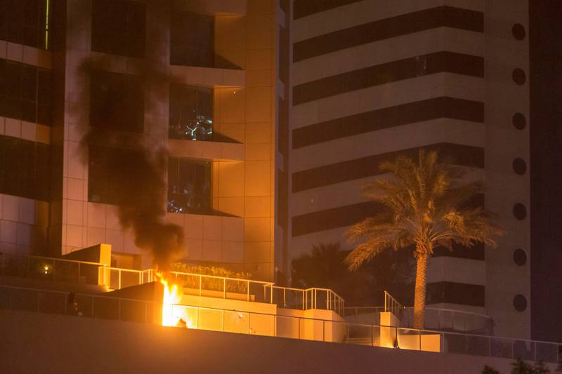 DUBAI. UNITED ARAB EMIRATES, 04 AUGUST 2017. A massive fire rips through The Marina Torch tower's southern corner. A fire on the plaza level of the building started by falling debris. (Photo: Antonie Robertson) Journalist: None. Section: National.