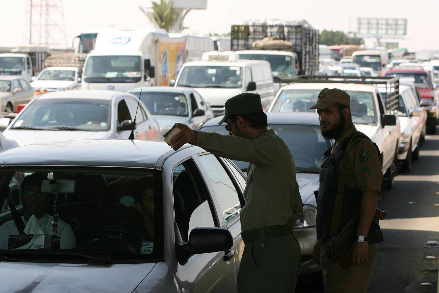 Saudi police check for identities and special Hajj permittions and visas as Saudi authorities is stopping any unauthorized for Hajj to get into Makkah, at the Shumais checkpoint few kilometers out of Makkah, Saudi Arabia on December 04, 2008. (Salah Malkawi/ The National)