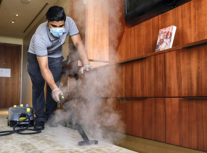 Abu Dhabi, United Arab Emirates, August 12, 2020.   Media Tour at The Westin Abu Dhabi Golf Resort & Spa on how tourism officials are conducting the go safe certification for hotels against Covid-19.  A hotel cleaner steams the carpet of a room.Victor Besa /The NationalSection:  NAReporter:  Haneen Dajani