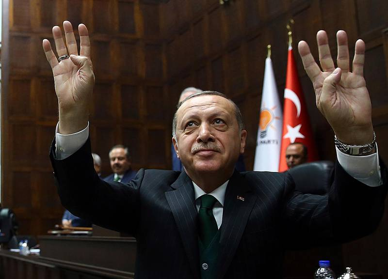 Turkey's President Recep Tayyip Erdogan salutes as he addresses his ruling Justice and Development Party members at the parliament in Ankara, Turkey, Tuesday, March 6, 2018.(Kayhan Ozer/Pool Photo via AP)