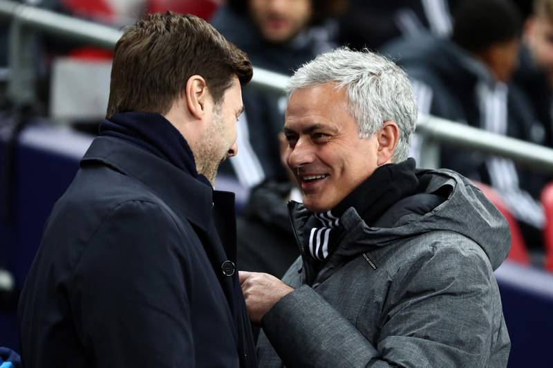 LONDON, ENGLAND - JANUARY 31: Jose Mourinho the head coach / manager of Manchester United is all smiles as he speaks with Mauricio Pochettino manager / head coach of Tottenham Hotspur before the Premier League match between Tottenham Hotspur and Manchester United at Wembley Stadium on January 31, 2018 in London, England. (Photo by Catherine Ivill/Getty Images)