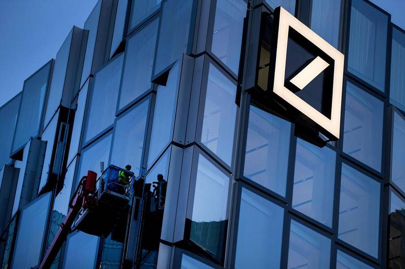 Workers stand on a hydraulic platform as they carry out maintenance on a new Deutsche Bank AG office building in Frankfurt, Germany, on Monday, Nov. 6, 2017. Demand for offices in Frankfurt and prime rents have climbed to a record as the city emerges as one of the favorites to attract financial firms from London in the run-up to the U.K.'s exit from the European Union, according to lobby group Frankfurt Main Finance. Photographer: Krisztian Bocsi/Bloomberg