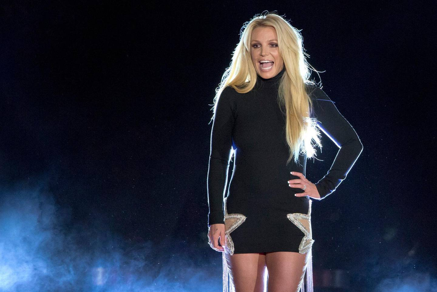 FILE - In this Oct. 18, 2018 file photo singer Britney Spears makes an appearance in front of the Park MGM hotel-casino in Las Vegas. Spears is putting her planned Las Vegas residency on hold to focus on her father's recovery from a recent life-threatening illness. The pop superstar announced Friday, Jan. 4, 2019 she is going on an indefinite work hiatus. (Steve Marcus/Las Vegas Sun via AP,File)