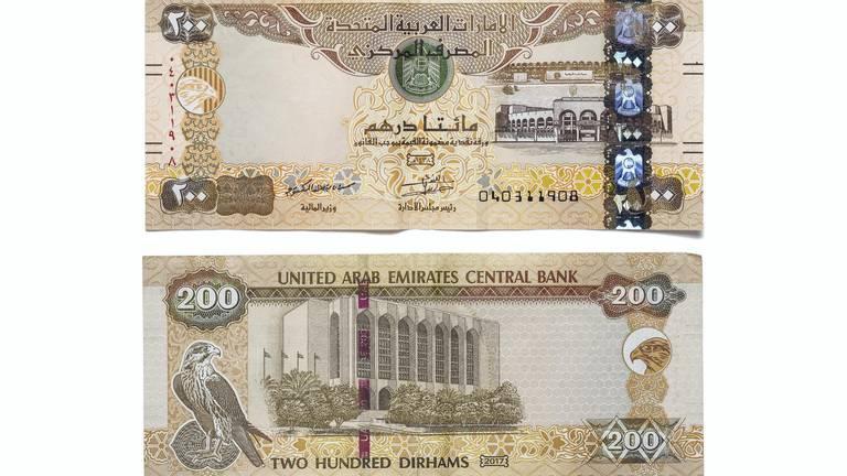 An image that illustrates this article UAE currency: the disappearing Dh200 note that changed colours many times