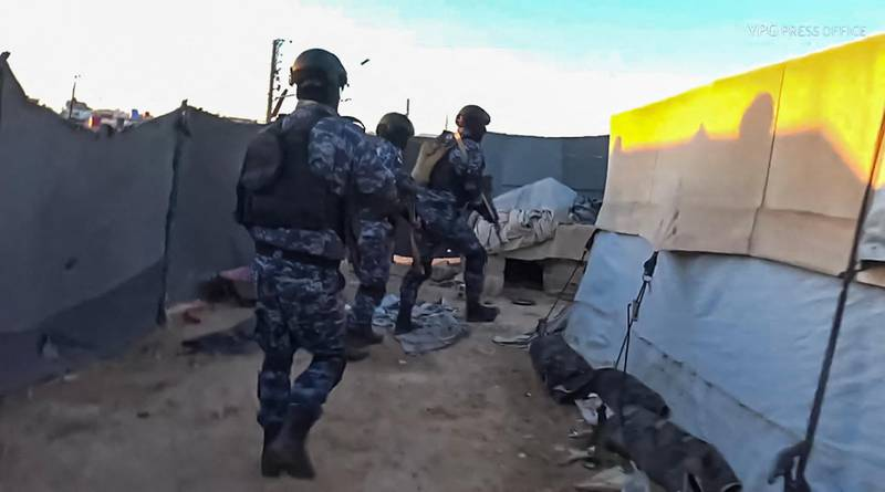 """An image grab from a video made available on the People's Protection Units' (YPG) Press office on March 28, 2021, shows Kurdish YPG forces conducting a security operation at the Kurdish-run Al-Hol camp which holds suspected relatives of Islamic State (IS) group fighters, in the northeastern Syrian Hasakeh governorate. Kurdish forces made dozens of arrests in a security operation launched at the camp for suspected family members of Islamic State group militants in northeast Syria, a war monitor and Kurdish officials said. Al-Hol is the largest such settlement controlled by Kurdish authorities, who warn it is emerging as an extremist powder keg following dozens of murders in the camp since the start of the year. - RESTRICTED TO EDITORIAL USE - MANDATORY CREDIT """"AFP PHOTO / YPG PRESS OFFICE"""" - NO MARKETING NO ADVERTISING CAMPAIGNS - DISTRIBUTED AS A SERVICE TO CLIENTS -  / AFP / YPG Press Office / - / RESTRICTED TO EDITORIAL USE - MANDATORY CREDIT """"AFP PHOTO / YPG PRESS OFFICE"""" - NO MARKETING NO ADVERTISING CAMPAIGNS - DISTRIBUTED AS A SERVICE TO CLIENTS -"""