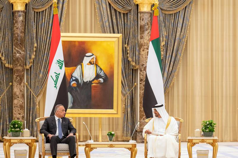 ABU DHABI, UNITED ARAB EMIRATES - April 04, 2021: HH Sheikh Mohamed bin Zayed Al Nahyan, Crown Prince of Abu Dhabi and Deputy Supreme Commander of the UAE Armed Forces (R), meets with HE Mustafa Al Kadhimi, Prime Minister of Iraq (L), during an official reception, at Qasr Al Watan.  ( Mohamed Al Hammadi / Ministry of Presidential Affairs ) ---