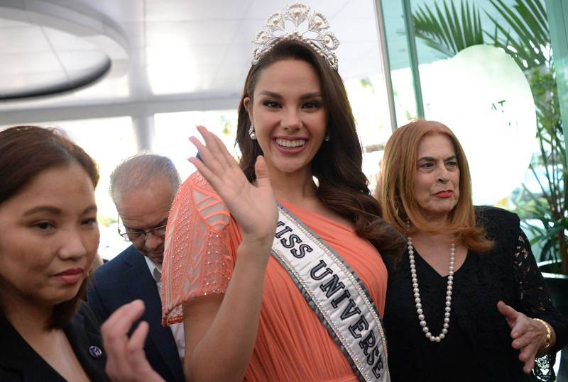 Miss Universe 2018 Catriona Gray of the Philippines (C) waves to fans as she arrives for a press conference in Manila on February 20, 2019. A parade in Gray's honour will be held in Manila on February 21. / AFP / Ted ALJIBE