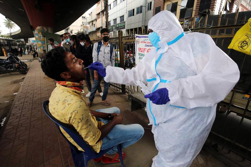 epa08668594 A health worker takes a swab sample from a person for a Covid-19 detection test in Bangalore, India, 14 September 2020. India has the second highest total of confirmed COVID-19 cases in world, reports state.  EPA/JAGADEESH NV
