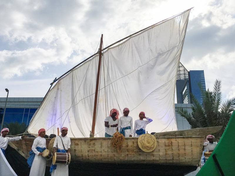 DUBAI, UNITED ARAB EMIRATES - NOVEMBER 28, 2018. A dhow with Emirati musicians is towed around Dubai Media City ahead of celebrations of UAE's 47th National Day.(Photo by Reem Mohammed/The National)Reporter: Section:  NA