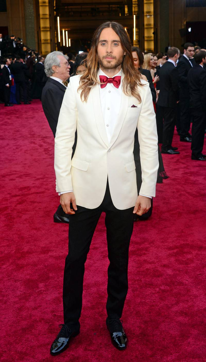 """Nominee for Best Actor In A Supporting Role  in """"Dallas Buyers Club"""" Jared Leto   arrives on the red carpet for the 86th Academy Awards on March 2nd, 2014 in Hollywood, California. AFP PHOTO FREDERIC J. BROWN (Photo by FREDERIC J.BROWN / AFP)"""