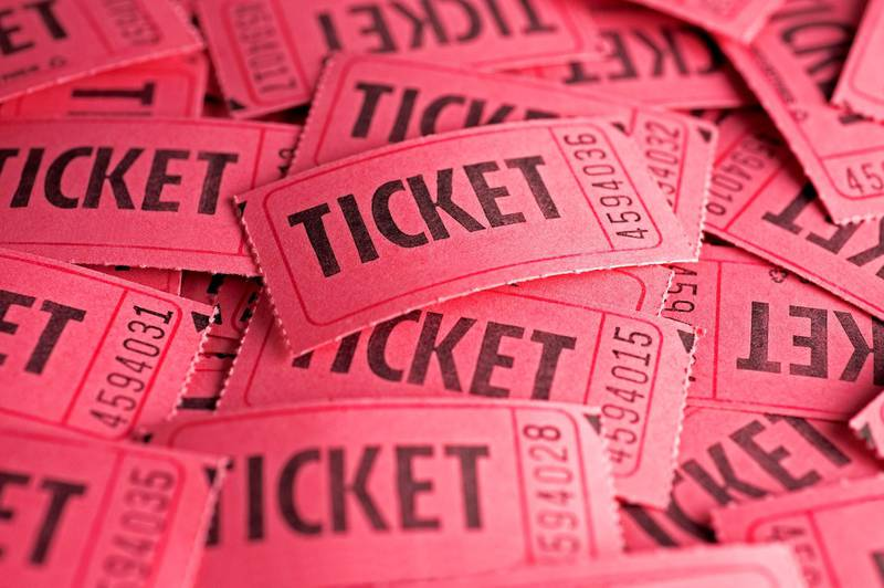 A background of a pile of tickets