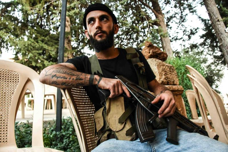 Bouday, Lebanon, 10 October 2020. Hassan Chamas taking a break after responding to shooting from the Noon family, following a Chamas clan meeting discussing regional response to the killing of family member, Mohammad Chamas by a member of the Jaafar family 4 October 2020.