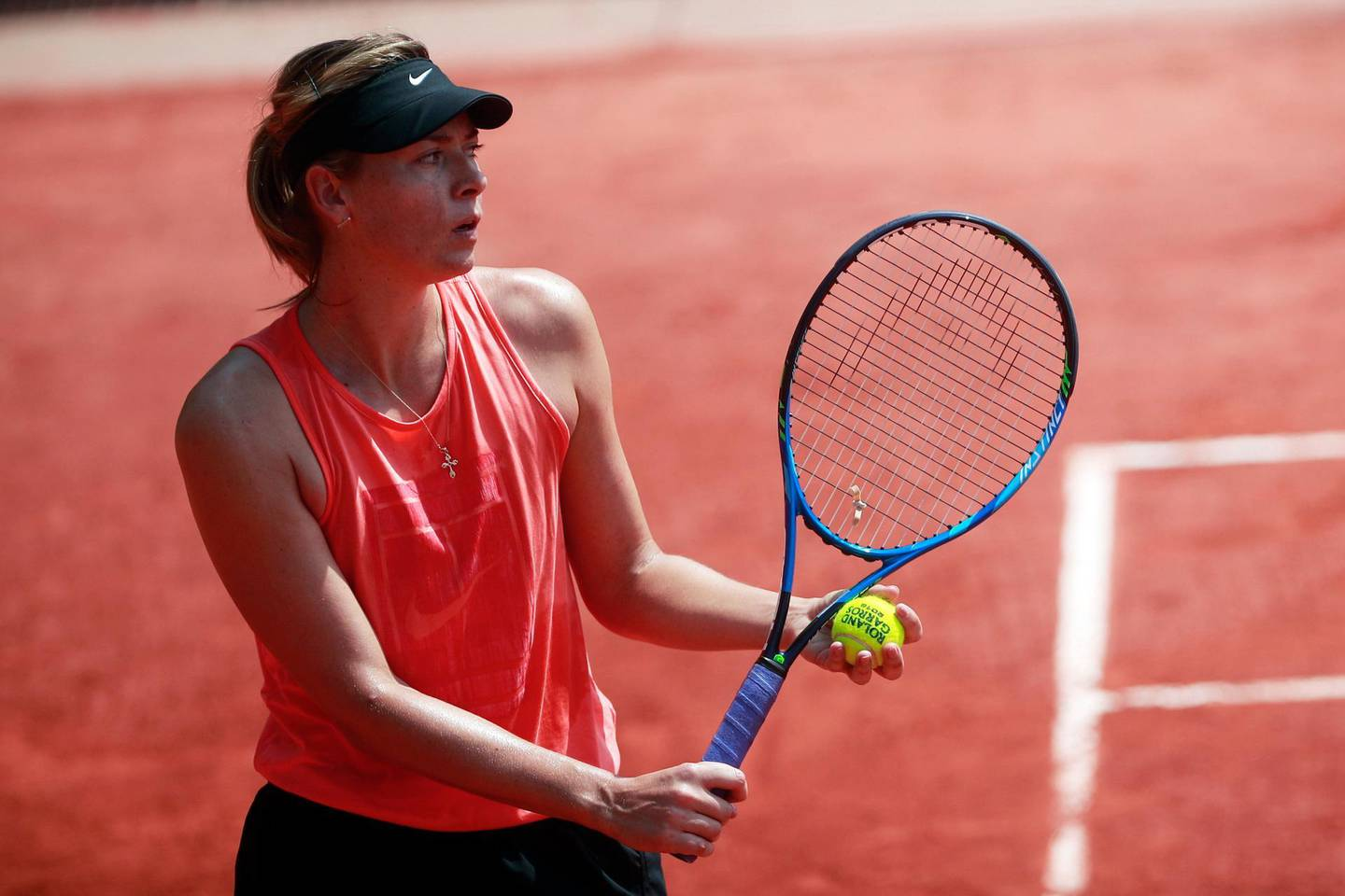epa06762630 Maria Sharapova of Russia during a training session on a court at Roland Garros in Paris, France, 25 May 2018. The 117th French Open tennis tournament starts with its first round matches on 27 May 2017.