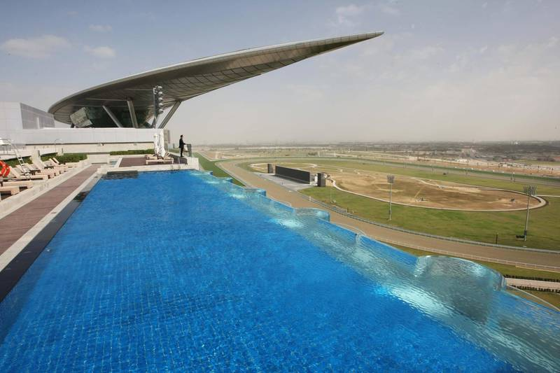 DUBAI.. 27th January 2010. The solar panelled roof of the main granstand at the new Maydan racecourse in Dubai seen from the rooftop swimming pool of the Meydan hotel.   Stephen Lock   /  The National  .  *** Local Caption ***  SL-meydan-019.jpg