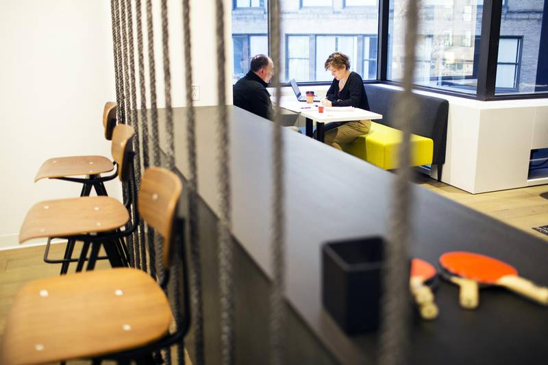 Employees sit in a booth at the Assemblyon2 common space, an amenities floor open to companies in the building, inside the Equity Office Management LLC 100 Summer Street offices in downtown Boston, Massachusetts, U.S., on Wednesday, Jan. 3, 2018. Companies in every industry, from autos to retail, have been scrambling to adjust to millennials' tastes and expectations, and commercial real estate is no exception. Blackstone Group LP,Brookfield Property Partners LP, Boston Properties, and other big landlords are spending millions to inject Silicon Valley playfulness into aging towers in big cities. Photographer: Adam Glanzman/Bloomberg