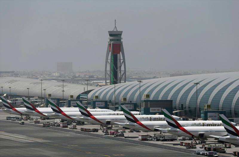 FILE - In this April 20, 2017 file photo, Emirates planes are parked at the Dubai International Airport in Dubai, United Arab Emirates. The airport said Monday, Jan. 28, 2019, that it remains the world's busiest for international travel and that it welcomed over 89 million passengers in 2018. (AP Photo/Kamran Jebreili, File)