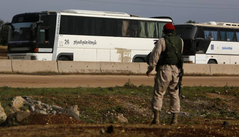 Buses carrying rebels who were evacuated from al-Rastan are seen in Homs countryside, Syria May 7, 2018. REUTERS/Omar Sanadiki