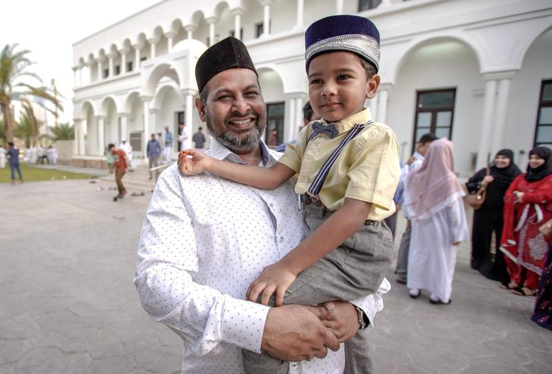 Abu Dhabi, United Arab Emirates, August 11, 2019.  Eid prayers at Zayed The 2nd Mosque.  Miran Omar and son Mohammed after Eid prayers.Victor Besa/The NationalSection:  NAReporter: Haneen Dajani
