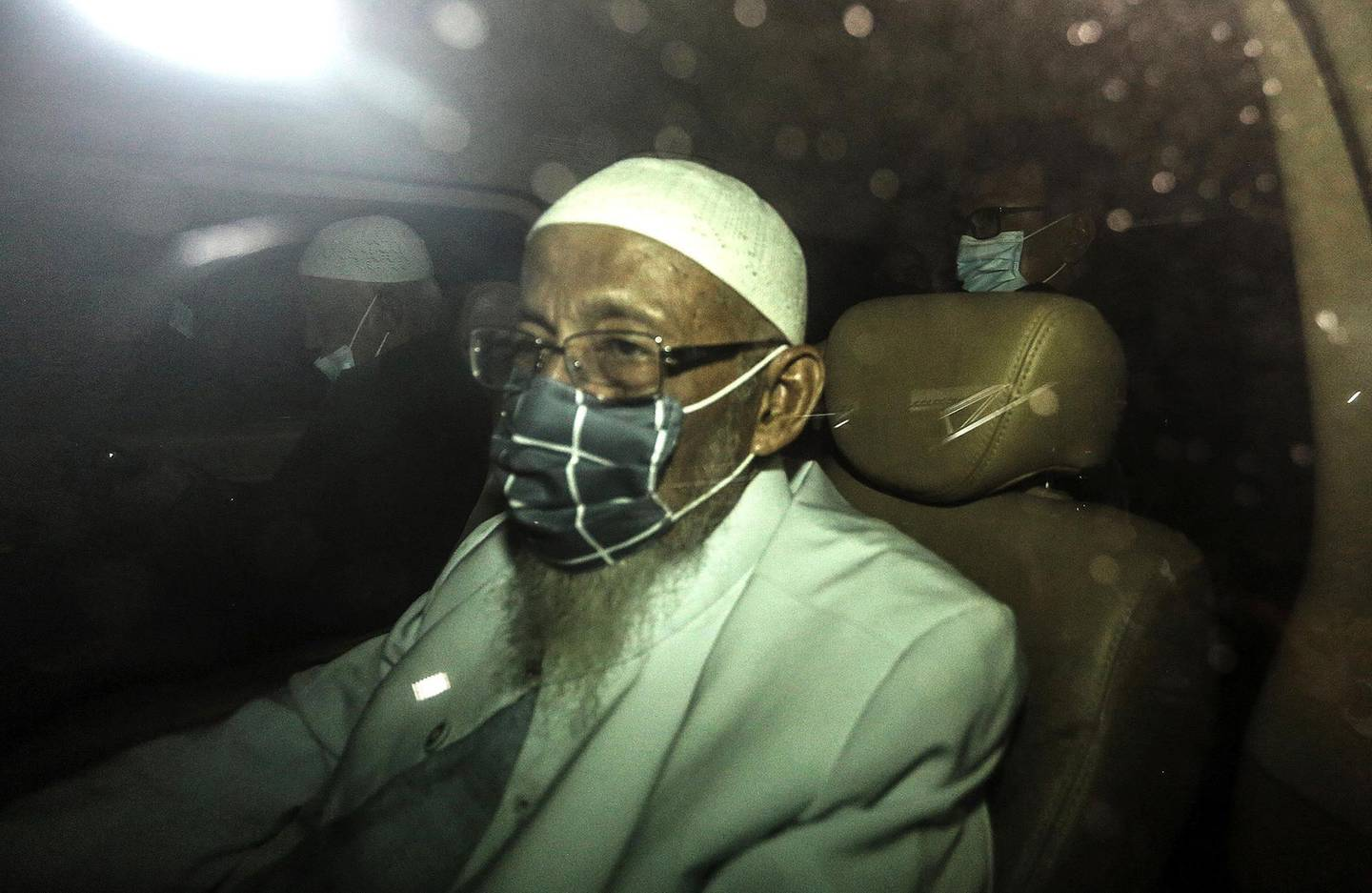 Abu Bakar Bashir, 82, once synonymous with militant Islam in the world's biggest Muslim majority nation, leaves the Gunung Sindur prison in Bogor, on the outskirts of Jakarta, after completing a 15 year prison term on January 8, 2021. / AFP / Aditya Aji