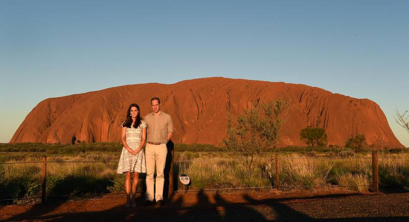 AYERS ROCK, AUSTRALIA - APRIL 22:  Catherine, Duchess of Cambridge and Prince William, Duke of Cambridge pose in front of Uluru, also known as Ayers Rock, on April 22, 2014 in Ayers Rock, Australia. The Duke and Duchess of Cambridge are on a three-week tour of Australia and New Zealand, the first official trip overseas with their son, Prince George of Cambridge. (Photo by William West -  Pool / Getty Images)