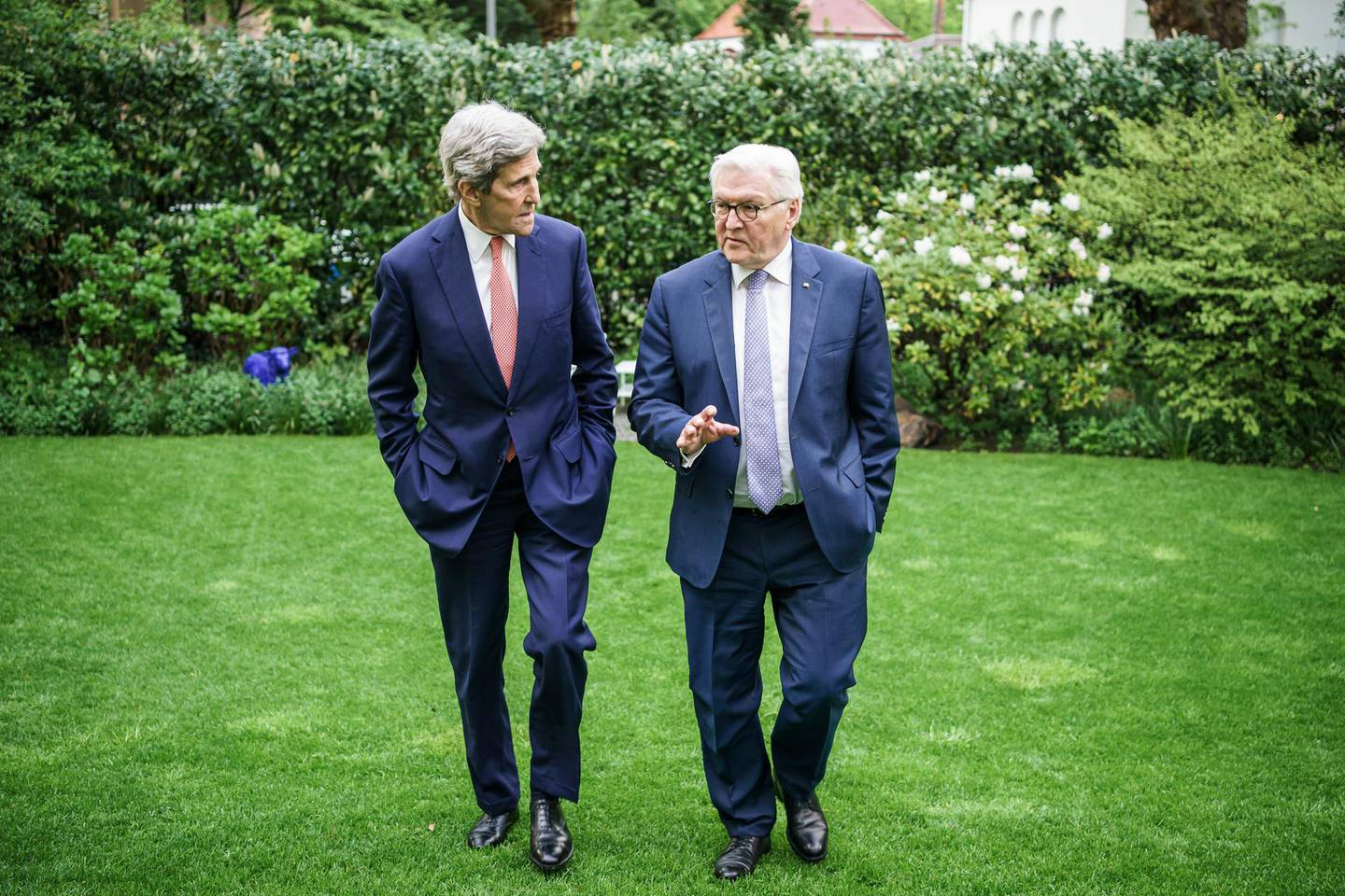 BERLIN, GERMANY - MAY 17:  In this handout photo provided by the German Government Press Office (BPA), German President Frank-Walter Steinmeier (R) talks to US Envoy for Climate State John Kerry in the garden of his villa during a private dinner on May 17, 2021 in Berlin, Germany.  (Photo by Jesco Denzel/Bundesregierung via Getty Images)