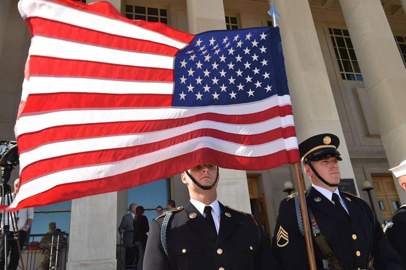 A US flag flies before Secretary of Defense Jim Mattis hosts an enhanced honor cordon welcoming Florence Parly, minister for the Armed Forces, France, to the Pentagon on October 20, 2017.  / AFP PHOTO / Paul J. Richards