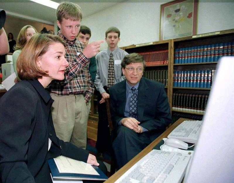Bill Gates (R) Chairman and CEO of Microsoft and his wife Melinda (L) listens to Josh Stack, 15, explaining the Demopolis, Alabama web site on a computer at the Demopolis Public library, February 24. Gates and his wife were in Alabama to see the work of the Gates Library Foundation, which has given over $2.7 million in grants to provide computer hardware in over 250 Alabama public libraries.