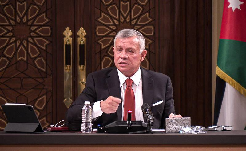 """A handout picture released by the Jordanian Royal Palace on March 23, 2021 shows Jordanian King Abdullah II speaking during a meeting with the speaker and heads of a number of committees at the House of Representatives in the capital Amman.  - RESTRICTED TO EDITORIAL USE - MANDATORY CREDIT """"AFP PHOTO / JORDANIAN ROYAL PALACE / YOUSEF ALLAN"""" - NO MARKETING NO ADVERTISING CAMPAIGNS - DISTRIBUTED AS A SERVICE TO CLIENTS  / AFP / Jordanian Royal Palace / - / RESTRICTED TO EDITORIAL USE - MANDATORY CREDIT """"AFP PHOTO / JORDANIAN ROYAL PALACE / YOUSEF ALLAN"""" - NO MARKETING NO ADVERTISING CAMPAIGNS - DISTRIBUTED AS A SERVICE TO CLIENTS"""