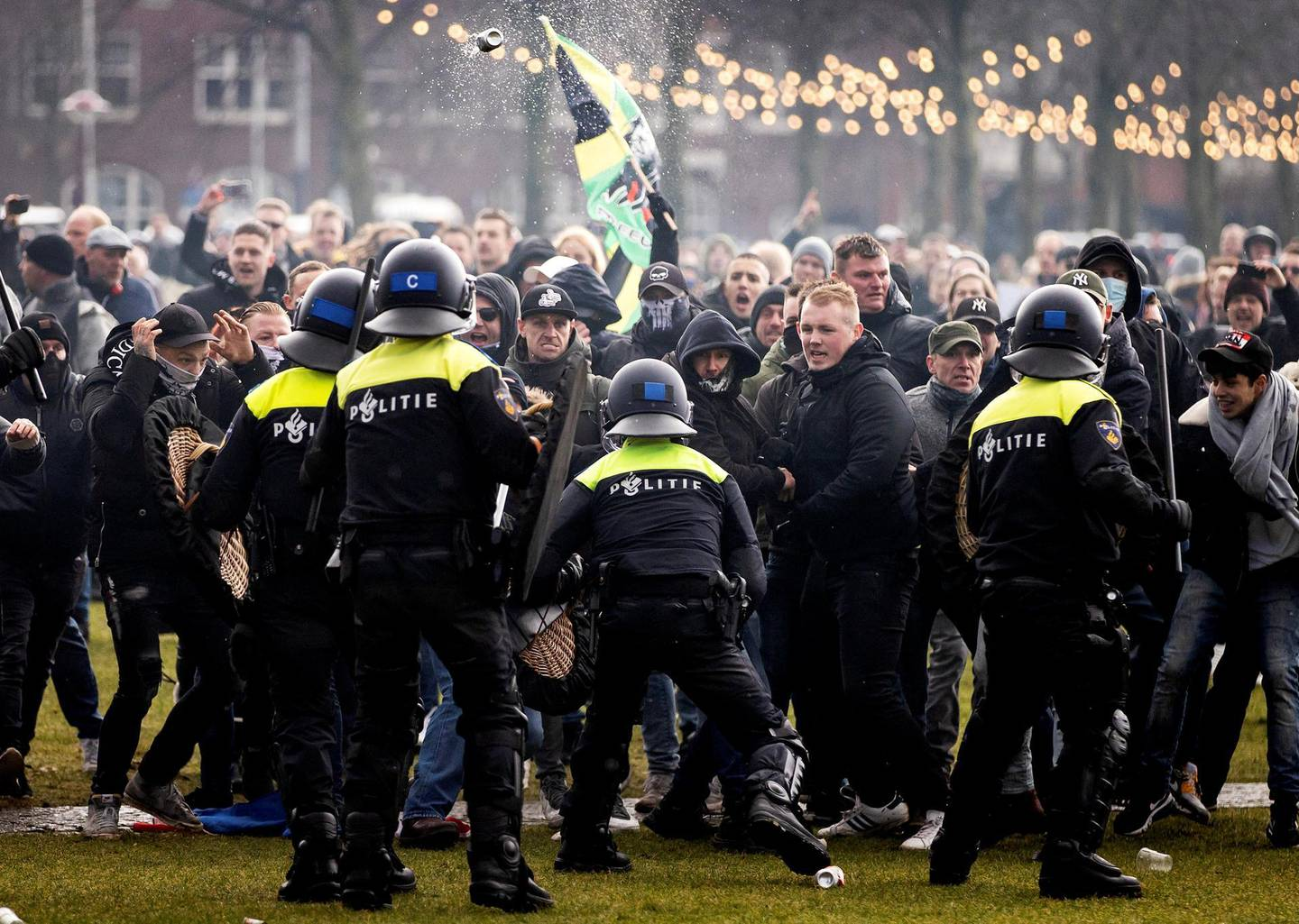 Anti-government activist face off with Dutch police during a protest to denounce ongoing restrictions related to the coronavirus disease (COVID-19) pandemic in Museumplein, Amsterdam on January 17, 2021. (Photo by ROBIN VAN LONKHUIJSEN / ANP / AFP) / Netherlands OUT