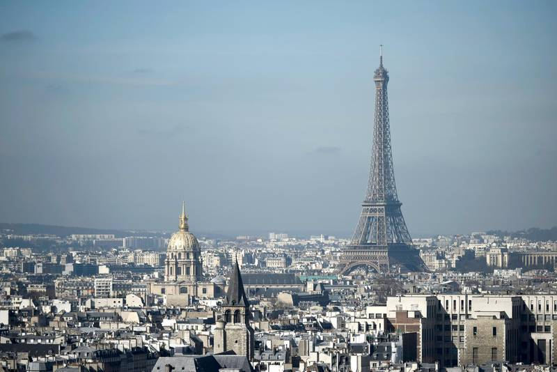 The Eiffel Tower and the dome of Les Invalides, are seen along the skyline of the French capital Paris from the tower at the Notre Dame Cathedral on March 14, 2017. - Paris in December 2016 suffered from a high air pollution index. (Photo by PHILIPPE LOPEZ / AFP)