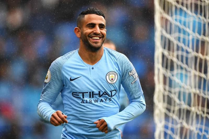 CARDIFF, WALES - SEPTEMBER 22:  Riyad Mahrez of Manchester City celebrates after scoring his team's fourth goal during the Premier League match between Cardiff City and Manchester City at Cardiff City Stadium on September 22, 2018 in Cardiff, United Kingdom.  (Photo by Stu Forster/Getty Images)