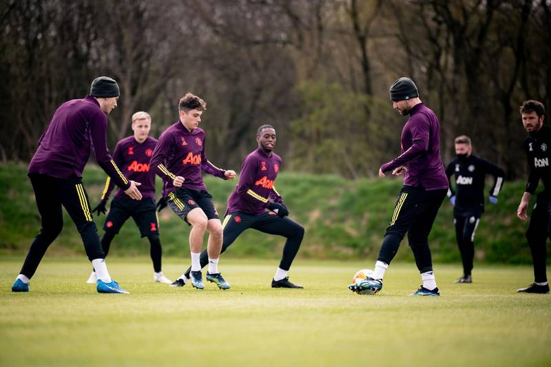 MANCHESTER, ENGLAND - APRIL 14: Victor Lindelof, Donny van de Beek, Daniel James, Aaron Wan-Bissaka, Luke Shaw of Manchester United in action during a first team training session at Aon Training Complex on April 14, 2021 in Manchester, England. (Photo by Ash Donelon/Manchester United via Getty Images)