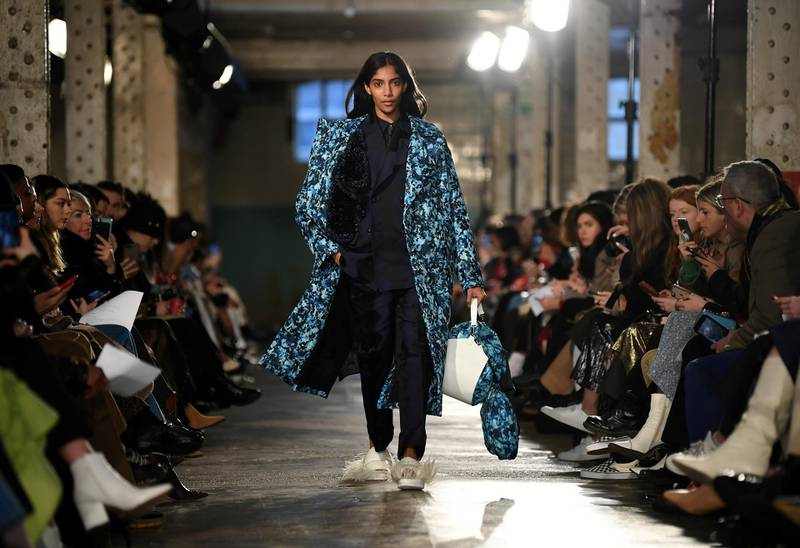A model presents a creation by fashion house TOGA during their catwalk show for the Autumn/Winter 2020 collection on the second day of London Fashion Week in London on February 15, 2020. (Photo by DANIEL LEAL-OLIVAS / AFP)