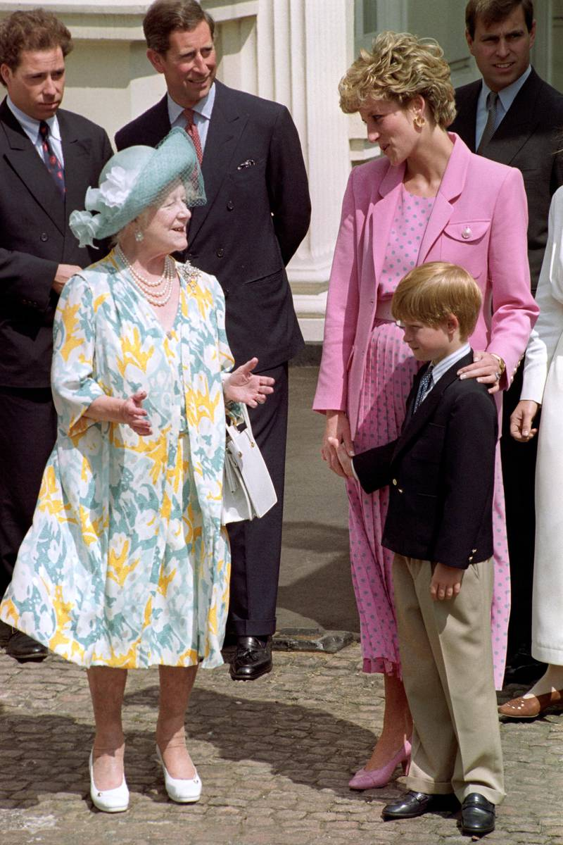 Queen Elizabeth the Queen Mother (L) speaks with Princess Diana and Prince Harry (R), as Viscount Linley (secons row L) and Prince Charles (second row C) look at them, celebrating Queen Mother's 92 birthday at Clarence House, London, Britain, 04 August 1992. EPA/GERRY PENNY
