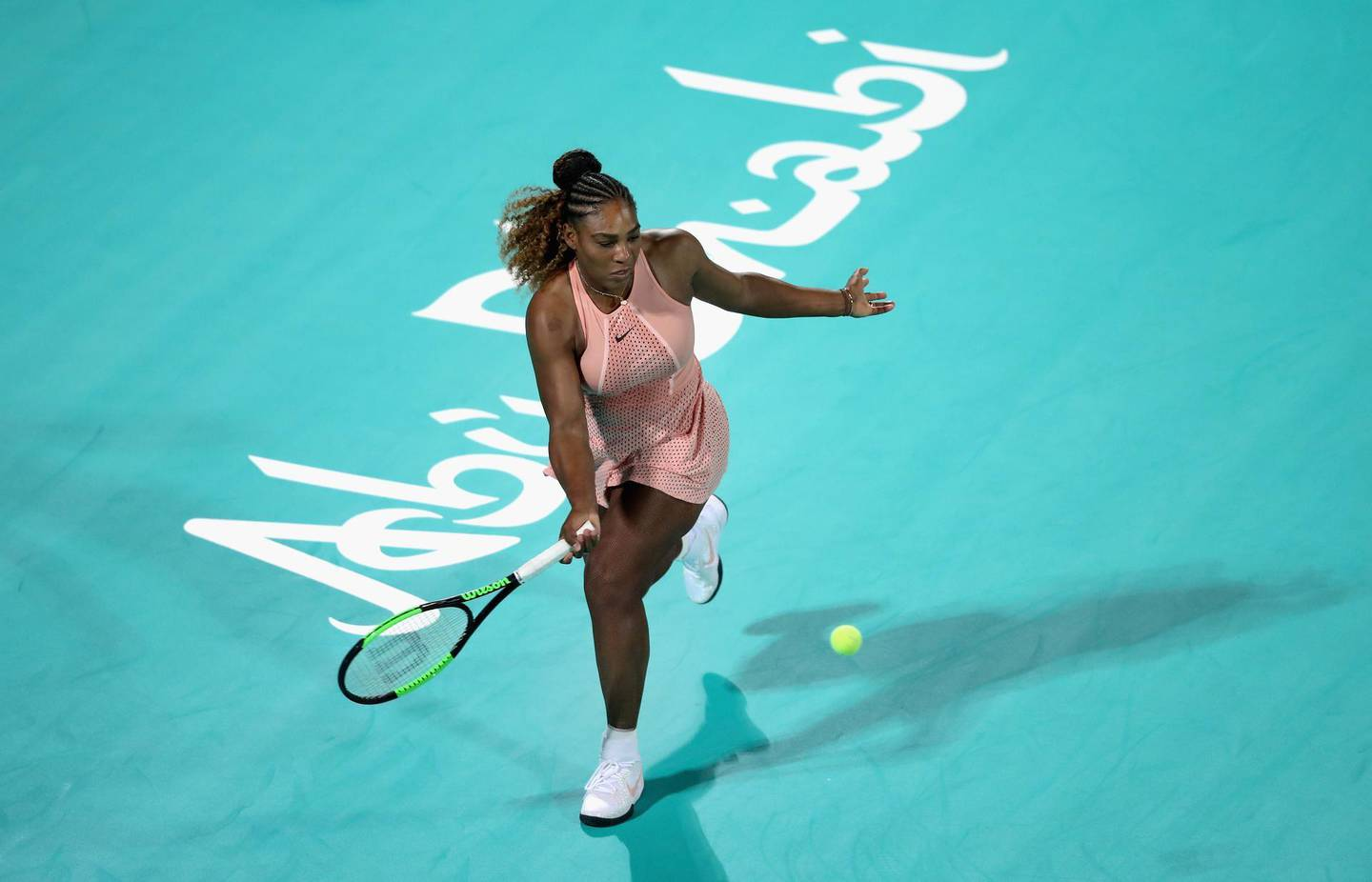 ABU DHABI, UNITED ARAB EMIRATES - DECEMBER 27:  Serena Williams of United States in action against Venus Williams of United States during her women's singles match on day one of the Mubadala World Tennis Championship at International Tennis Centre Zayed Sports City on December 27, 2018 in Abu Dhabi, United Arab Emirates.  (Photo by Francois Nel/Getty Images)