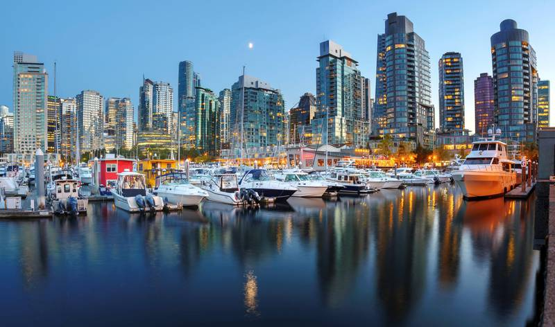 Evening views of city skyline from harbor. Vancouver. British Columbia. Canada. (Photo by: Education Images/Universal Images Group via Getty Images)