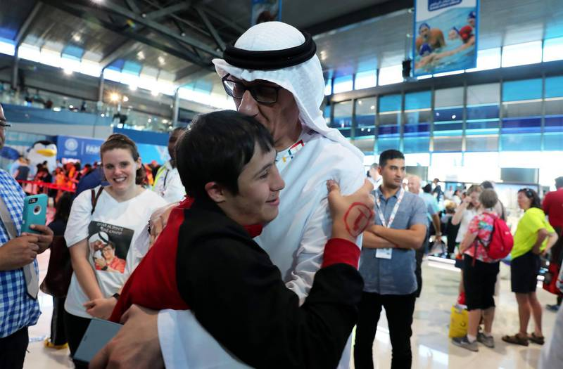 DUBAI , UNITED ARAB EMIRATES , March 20 – 2019 :- Omer Alshami from UAE with his father Sharif Alshami after the victory ceremony of the 4x50m freestyle relay at the Special Olympic games held at Hamdan Sports Complex in Dubai. ( Pawan Singh / The National ) For News/Instagram/Online/Big Picture . Story by Ramola